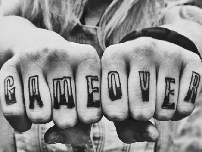 Game over has been tattooed on Ms Snow's knuckles.