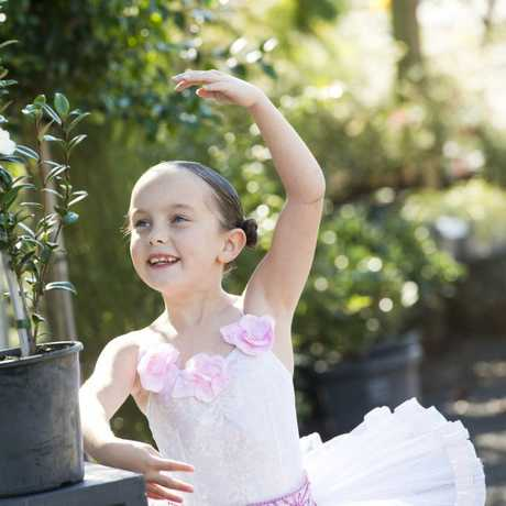 BALLET BLOOM: Ballerina Phoebe Mathey, 7, with new camellia Ballerina . Wednesday, 5th Jul, 2017.