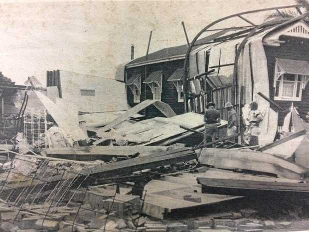 BRUTAL: The reinforced steel joists from the roof of the depot of Chaves' Enterprises wrapped themselves around the home of Hilda Charles on Maryborough St.