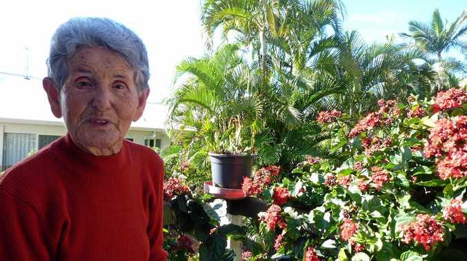STRONG LADY: Hervey Bay's Eliza Albrecht in her beloved garden.