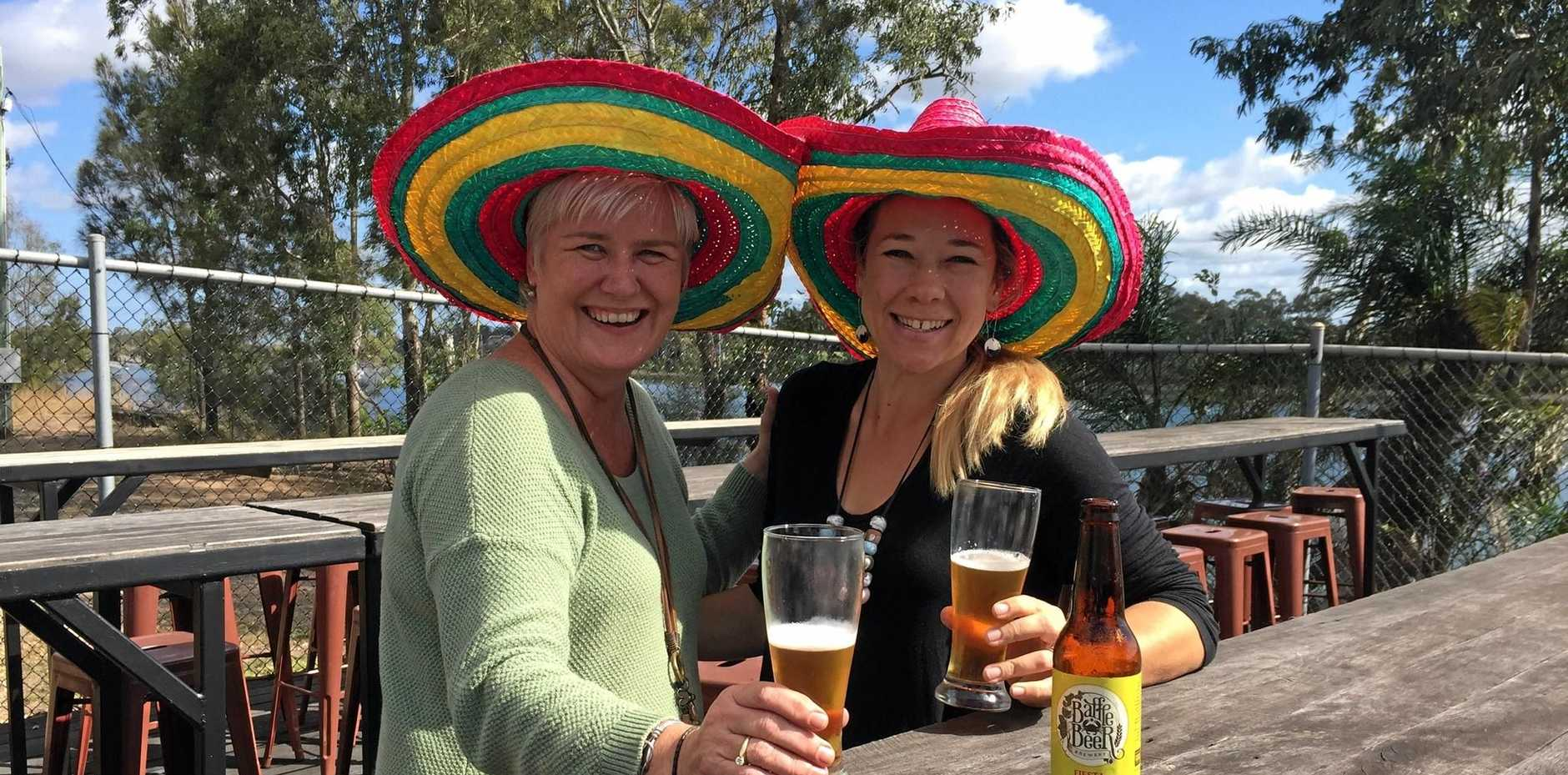 FIESTA FUN: Karen Wittkopp and Jay Feather drinking a Fiesta chilli lime pale ale by Baffle Beer which will be available at the Chilli and Lime Fiesta next Friday.