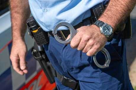 A police officer's life was threatened as he attempted to handcuff a man in a Mount Morgan home.