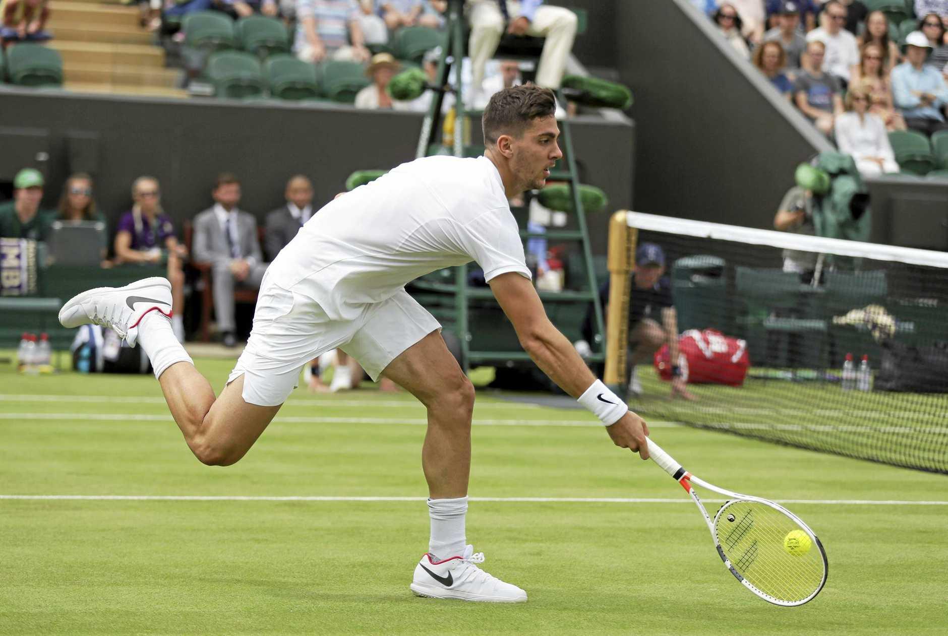 Australia's Thanasi Kokkinakis lost 6-3 3-6 7-6 (7-2) 6-4 loss to US Open winner Juan Martin del Potro in the first round of Wimbledon.
