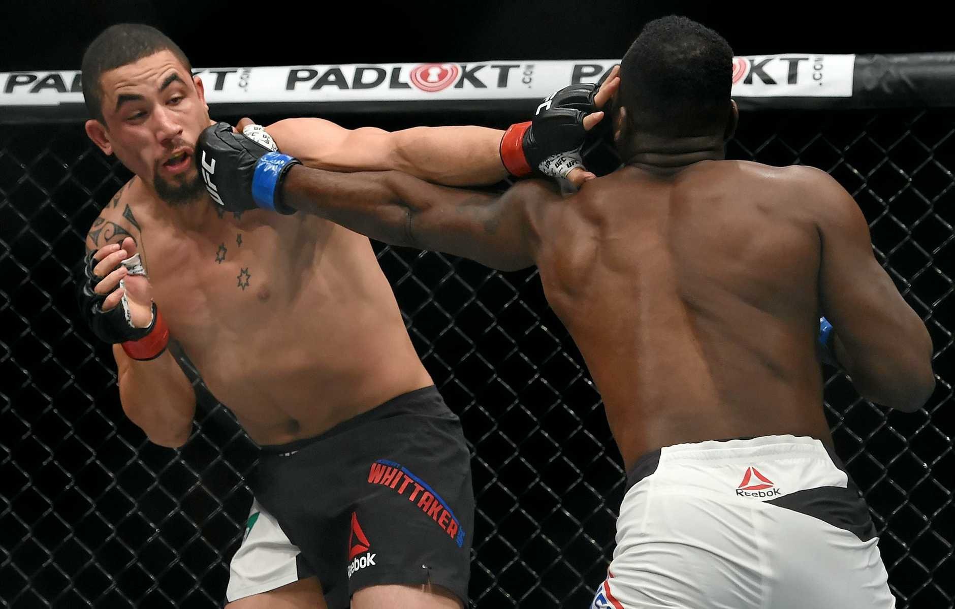 TITLE HOPES: Robert Whittaker (pictured fighting against Derek Brunson) will become the first Australian to hold a UFC title if he can overcome Yoel Romero to secure the Interim Middleweight title at UFC 213 this weekend.