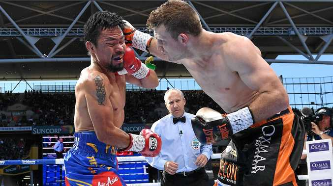 Manny Pacquiao (left) wears a blow from Jeff Horn during their WBO world welterweight title fight.