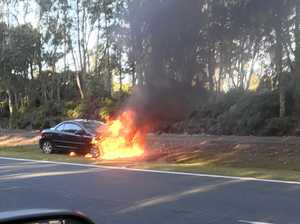 Car engulfed in flames outside of airport