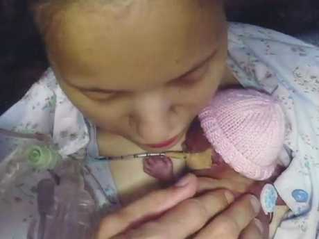 Ms Mapp has had four high risk pregnancies, and shared pictures with her daughter Mia who was born premature and sadly died. Picture: Channel 7