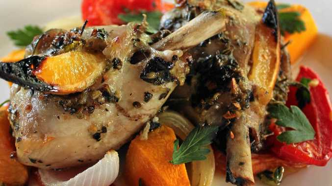 Greek-style baked lemon chicken with herb roasted vegetables.