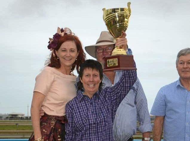 Glenda Bell with the winning trophy.