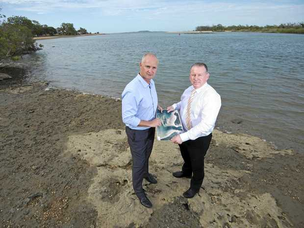ON TRACK: Gladstone MP Glenn Butcher and Ports Corporation CEO Peter O'Sullivan at the mouth of the Boyne River in February announcing the plans.