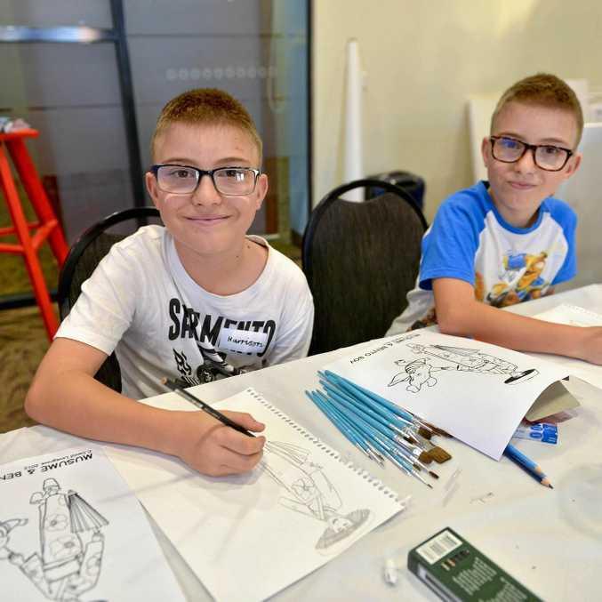 GOOD FUN: Harrison and Connor Schumacher, both 10, draw at David Lovegrove's manga art workshop.