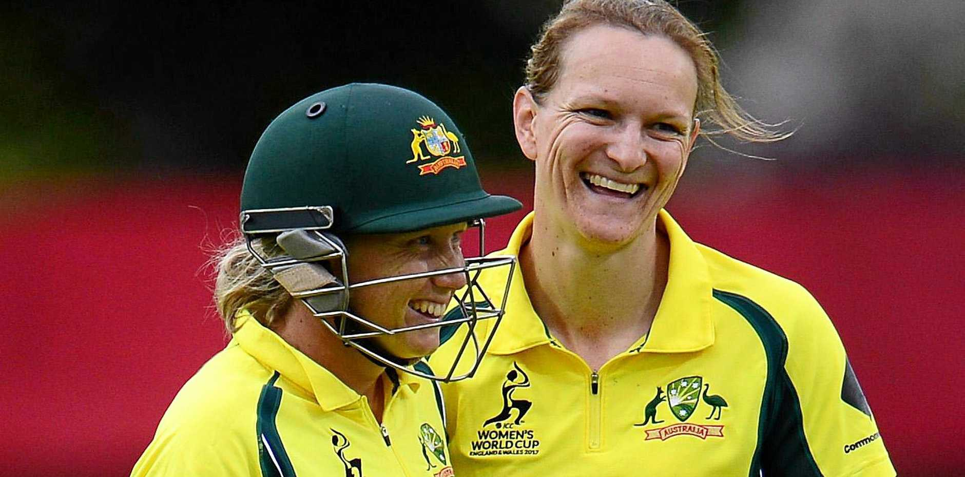 Australian bowler Sarah Aley (right) being congratulated by Alyssa Healy after claiming a wicket against Pakistan.