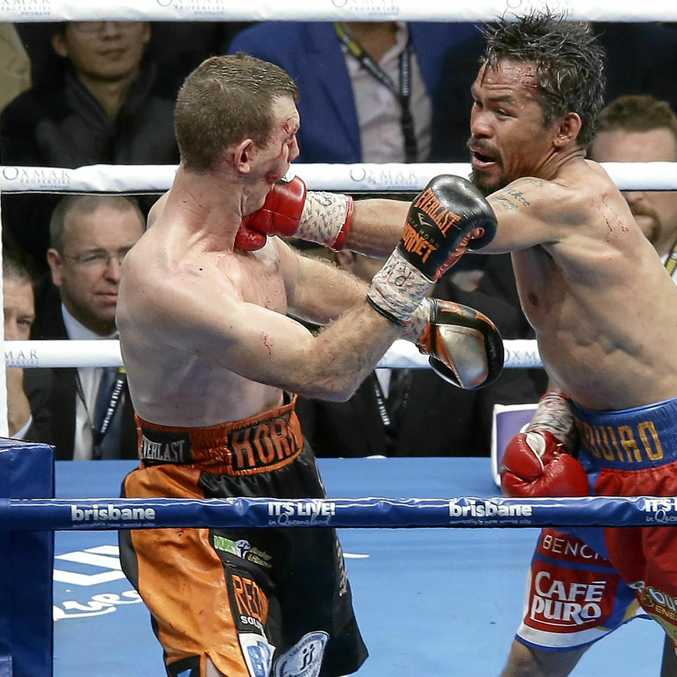 ON TARGET: Manny Pacquiao lands a shot on Jeff Horn during their WBO World welterweight title bout in Brisbane.