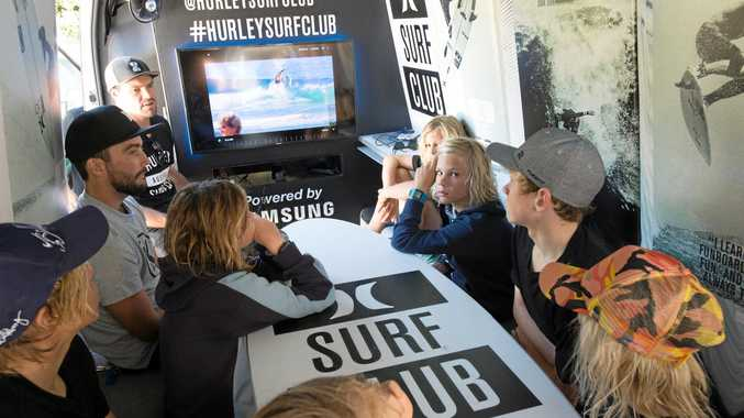 TOP COACHING: The Hurley Surf Club rolled on to Diggers Beach and provided Coffs groms with state-of-the-art video coaching from pros.