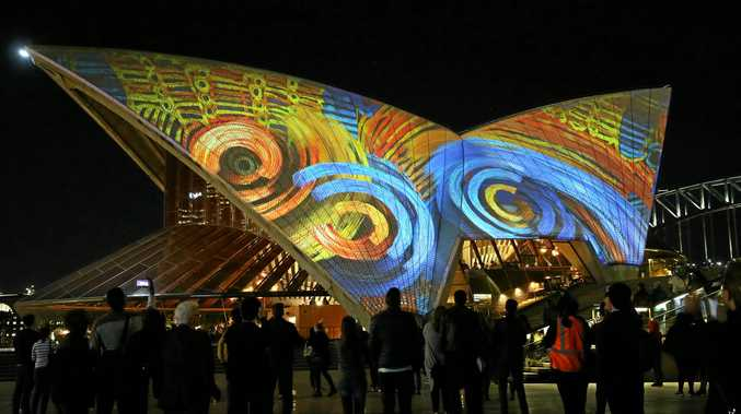 FRESH TRADITION: The sails of the Sydney Opera House are illuminated by the Badu Gili: Water Light animation.