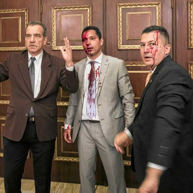 Opposition politicians in Venezuela have been attacked in the National Assembly in Caracas.