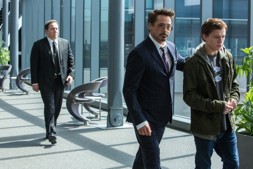 Jon Favreau, Robert Downey Jr and Tom Holland in a scene from the movie Spider-man: Homecoming.
