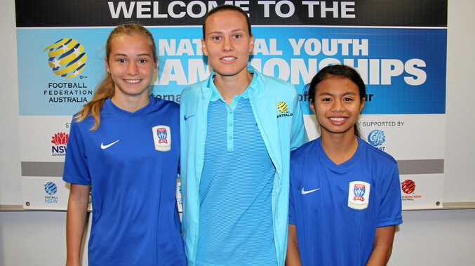 TOP TALENT: Chelsea Williams and Emma Shipperlee (right) from the Coffs Coast were presented their 2017 FFA National Youth Championships shirts by Matilda midfielder Emily van Egmond.