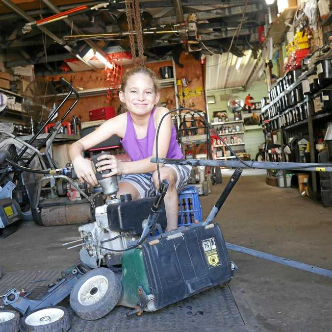 Taylor Hudson, 10, is spending a part of her school holidays taking apart lawn mowers to raise money for homeless people.
