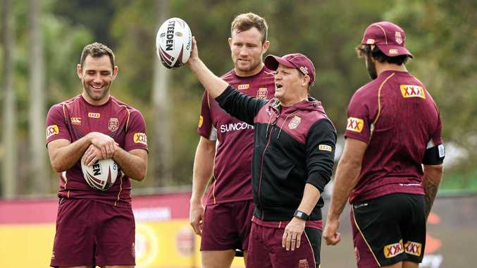 HAVING A BALL: Maroons coach Kevin Walters shares a light hearted moment with (from left) Cameron Smith, Gavin Cooper and Johnathan Thurston during Queensland camp ahead of Game Two last month.