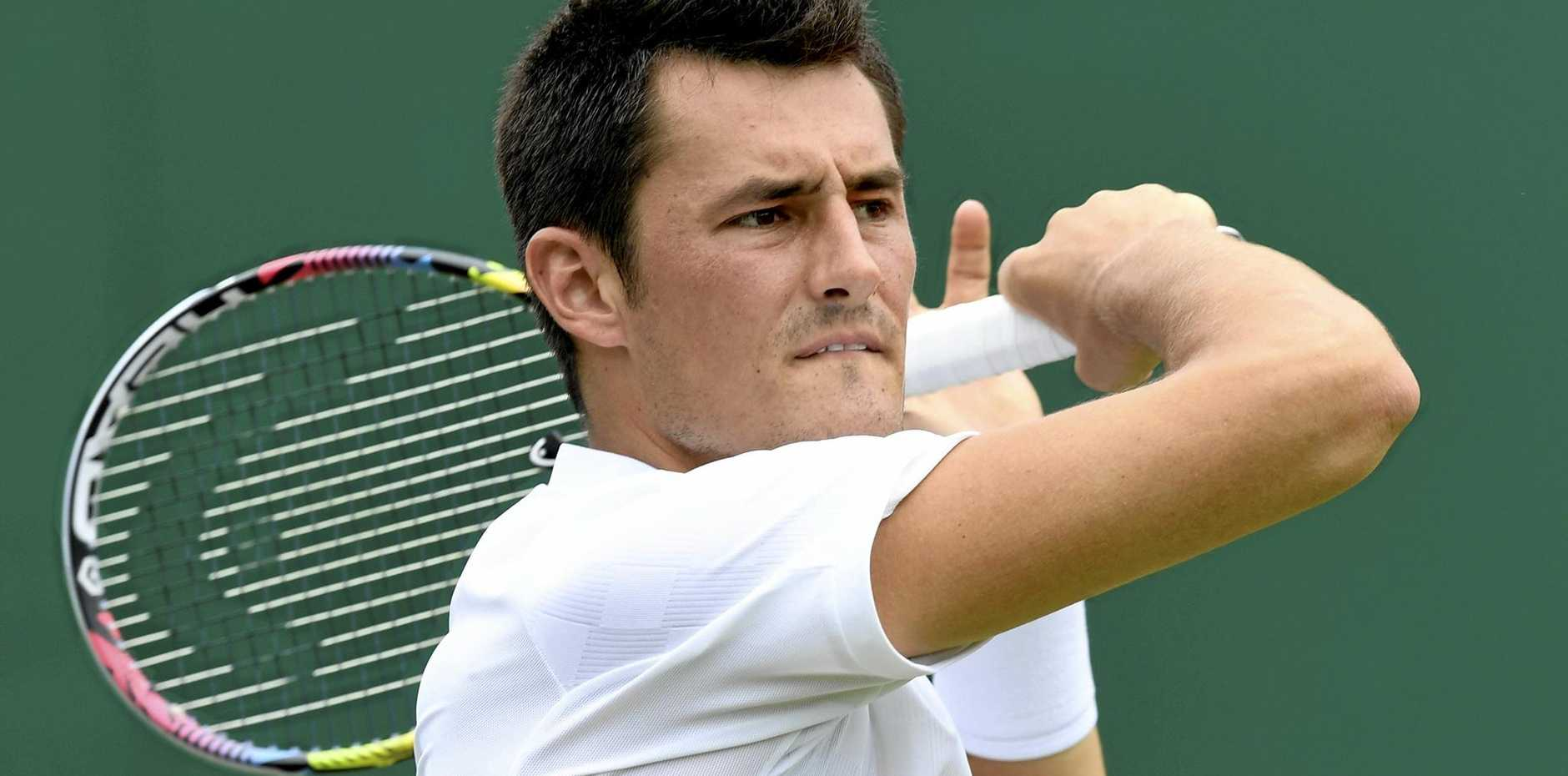 Bernard Tomic in action against Mischa Zverev at the All England Lawn Tennis Club