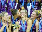 Laura Geitz celebrates with Firebirds team mates after winning the grand final match of the 2016 ANZ Championship
