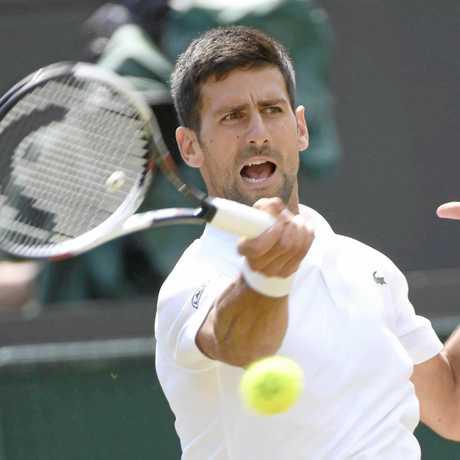 Novak Djokovic of Serbia returns a shot during a Wimbledon second-round match against Adam Pavlasek of the Czech Republic.