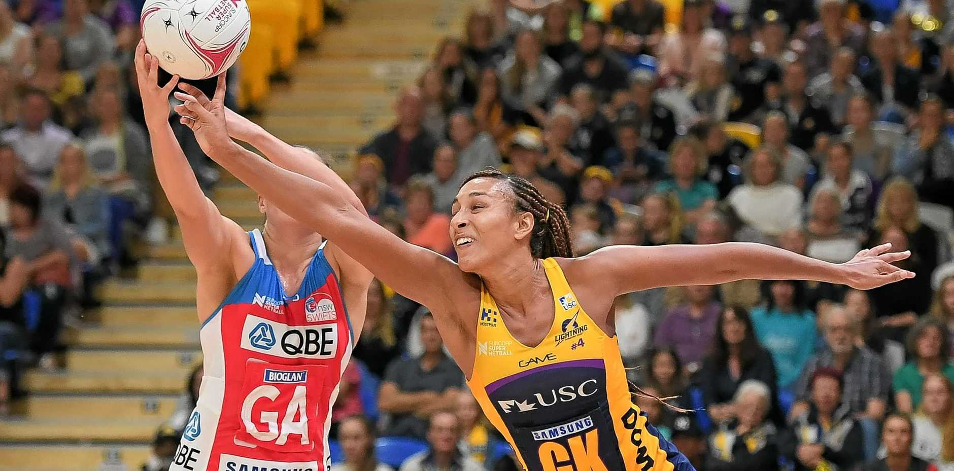 FORCEFUL: Geva Mentor of the Lightning competes for the ball during a Super Netball match against the Swifts at the University of the Sunshine Coast Stadium.