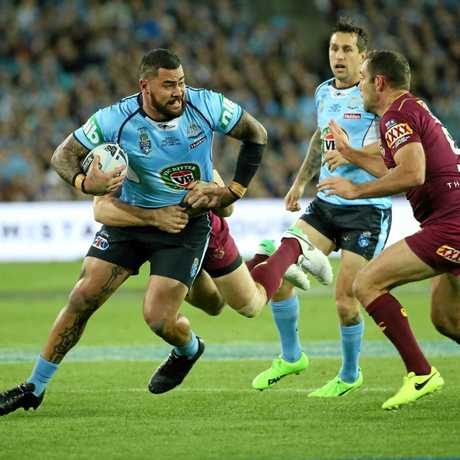 Andrew Fifita of the Blues (left) runs with the ball during State of Origin Game II between the NSW Blues and Queensland Maroons at ANZ Stadium in Sydney on Wednesday, June 21, 2017. (AAP Image/David Moir) NO ARCHIVING, EDITORIAL USE ONLY
