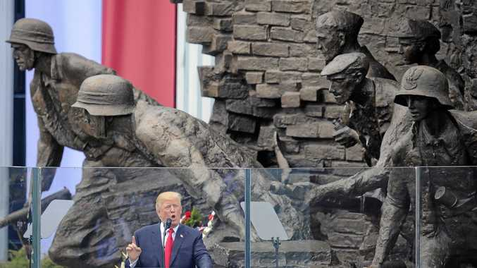 US President Donald Trump delivers a speech in Krasinski Square, with a backdrop of the monument commemorating the 1944 Warsaw Uprising against the Nazis, in Warsaw, Poland.