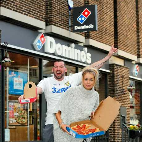 """""""We got a bit frisky and one thing led to another,"""" the couple, seen posing outside the Domino's in question, explained."""