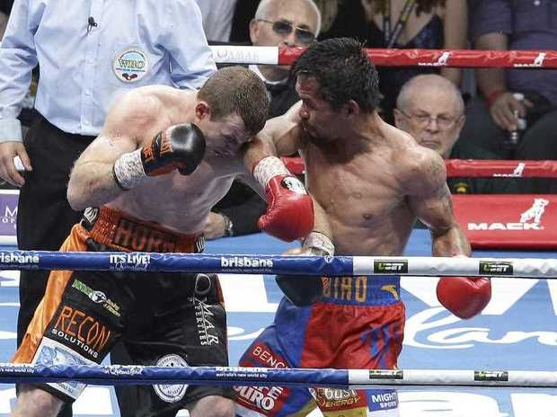 Manny Pacquiao and Jeff Horn fight during their WBO World welterweight title bout in Brisbane, Australia, Sunday, July 2, 2017. Pacquiao lost his WBO welterweight world title to Horn in a stunning, unanimous points decision in the Sunday afternoon bout billed as the Battle of Brisbane in front of more than 50,000 people.