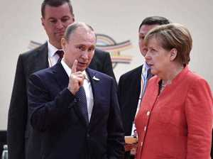 G20 Summit: Merkel's epic eye-roll at Putin caught on camera
