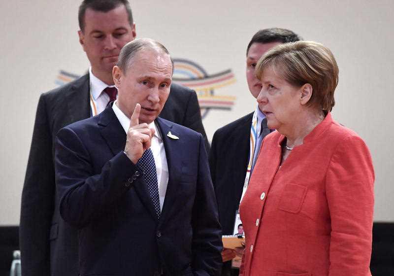 Angela Merkel rolls her eyes as Vladamir Putin speaks.