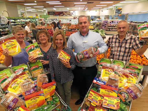 FOODBANK VOLLIES: L to R Shirley Monger, Julie Scotts, Jane Spies, Woolworths store manager Graham Loney, and Karl Neuner