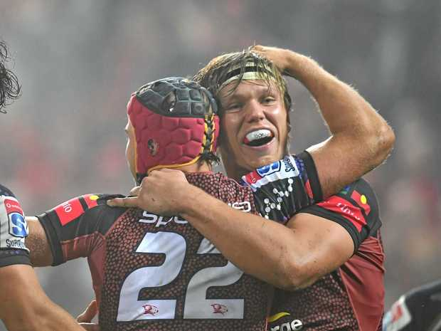 Hamish Stewart (left) of the Reds celebrates with teammate Adam Korczyk after scoring a try.