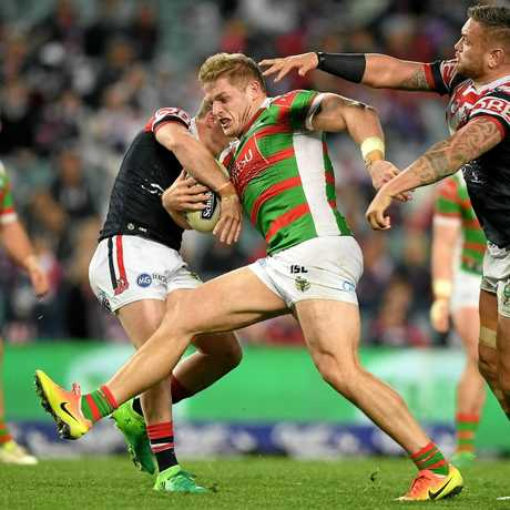 George Burgess of the Rabbitohs is tackled by Luke Keary (left) and Jared Waerea-Hargreaves of the Roosters.