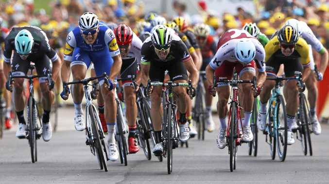 German Marcel Kittel (second left) sprints to the finish line ahead of Norway's Edvald Boasson Hagen (centre) to win the seventh stage of the Tour de France.