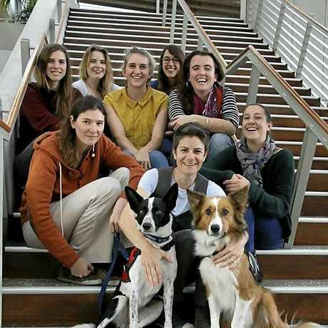 Dr Celine Frere, front centre with detection dogs Maya and Baxter, surrounded by her USC research team (clockwise from front left) Dr Romane Cristescu, Katrin Hohwieller, Sarah Ball, Nicola Kent, Coralie Delme, Kasha Strickland, Bethan Littleford.