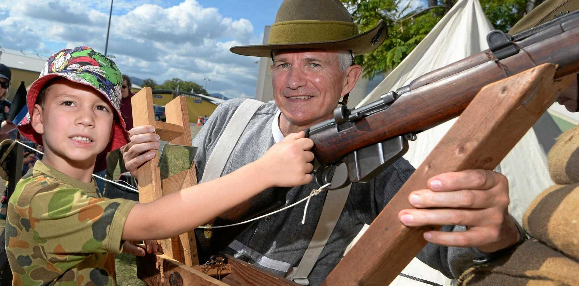 Flynn Hamiltaon (5) and David Bell from the 9th Bn Living History Unit at the Talisman Sabre open day at the Rockhampton Show Grounds on Saturday.