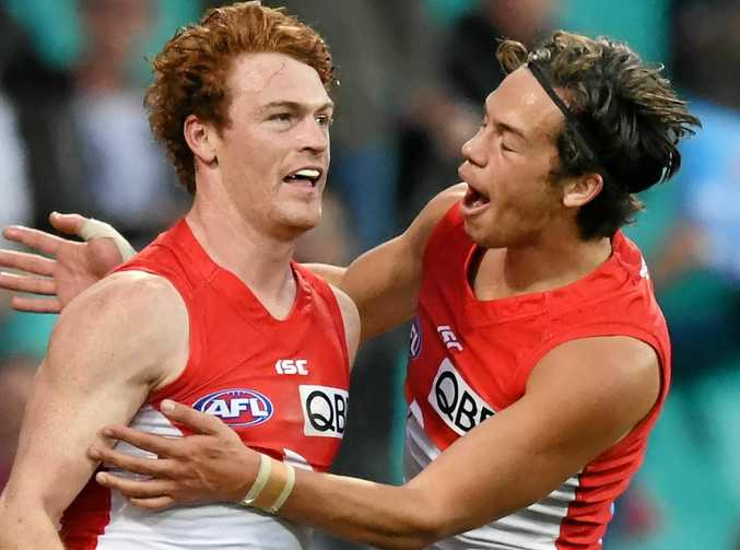 Gary Rohan of the Swans (left) celebrates with teammate Oliver Florent after scoring a goal.