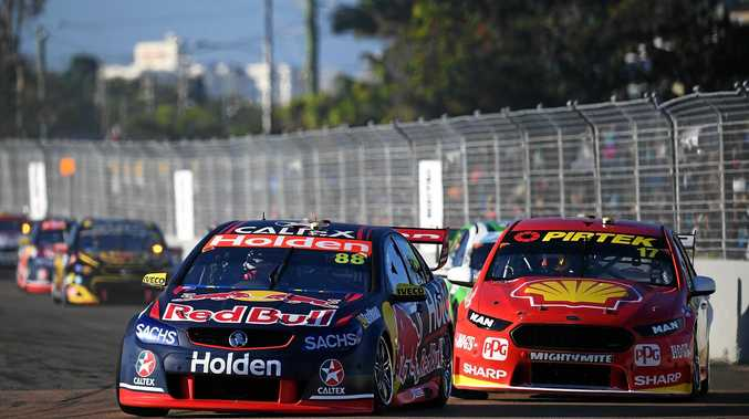 Jamie Whincup (left) in the No.88 Red Bull Holden Racing Team Holden Commodore VF leads Scott McLaughlin in the No.17 Shell V-Power Racing Team Ford Falcon FGX during Race 13 at the Townsville 400.