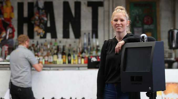 Bar manager Ashley Hooker at The Elephant Hotel with new ID scanners that the bar has had to buy for $3000 each.
