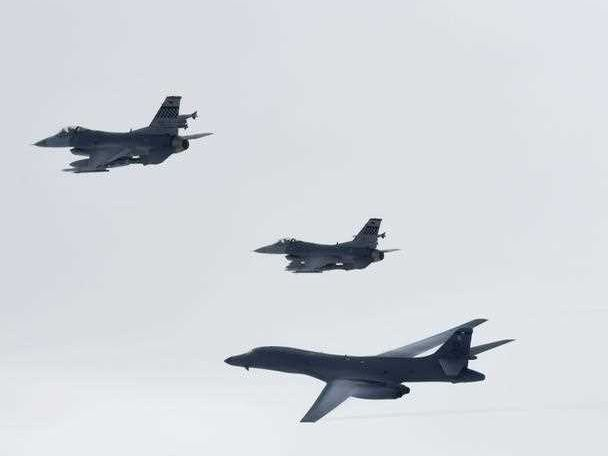 US long-range strategic bomber B-1B Lancers, flanked by F-15K and F-16 fighter jets, fly through the sky over South Korea's east, 08 July 2017. The South Korean and US air forces staged a joint drill in a stern warning to North Korea against its latest test-firing of an intercontinental ballistic missile (ICBM) on 03 July.