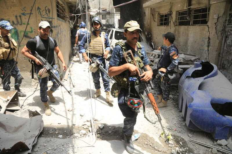 IRAQ, Mosul: Members of the Iraqi forces patrol in the old city of Mosul on July 4, 2017 as the offensive to drive Daesh fighters away from the city continues.