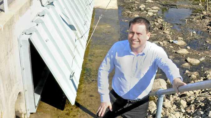WATER SOLUTION: Gladstone Regional Council Mayor Matt Burnett inspects the new Young St flood gates.