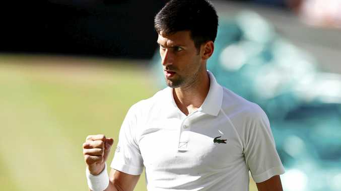 Novak Djokovic scores against Ernests Gulbis of Latvia in their third round match  at the All England Lawn Tennis Club, in London