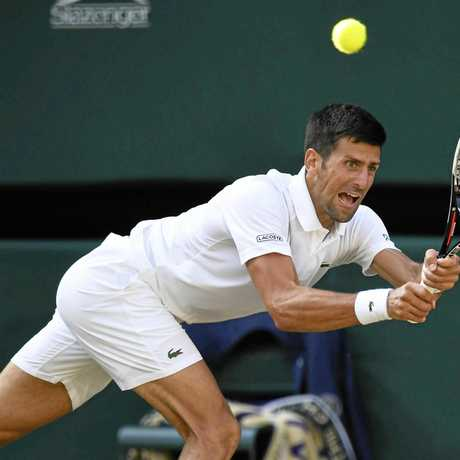 Novak Djokovic hits a return during the third round clash against Ernests Gulbis