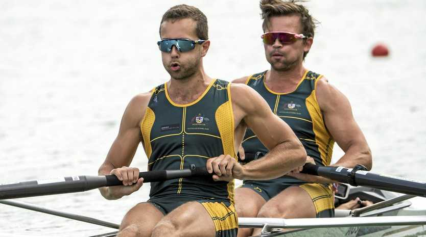 SILVER LINING: Australia's Nathan Bowden (left) and Benjamin Coombs won silver behind Germany in the men's coxed pair at the rowing World Cup.