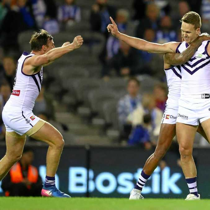 HERO: Ryan Nyhuis is congratulated by teammate Brad Hill after kicking one of his four goals on debut for Fremantle.